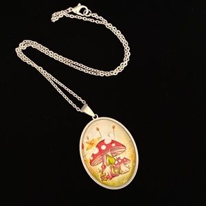 Spotted Mushroom glass and stainless steel necklace fairy core